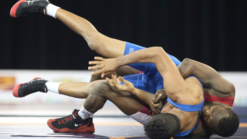 Wrestlers grappling on the floor