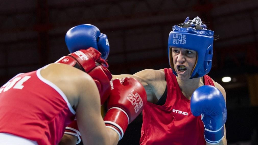 Sabrina Aubin punches opponent