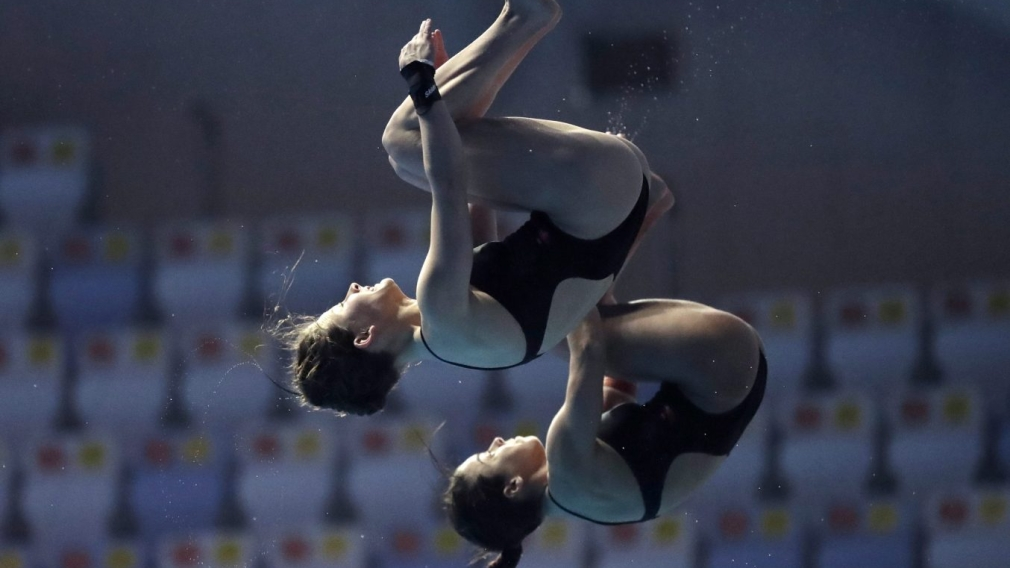 Canada's Meaghan Benefeito and Caeli McKay compete in the 10m platform women's synchro diving