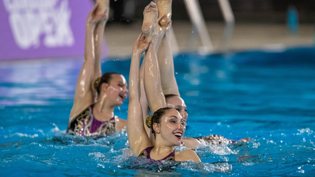 Artistic swimmer performs a routine in the water