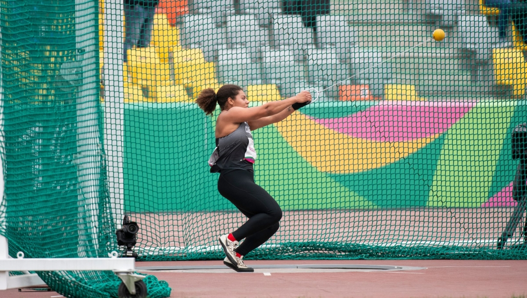 Camryn Rogers spinning in hammer throw circle