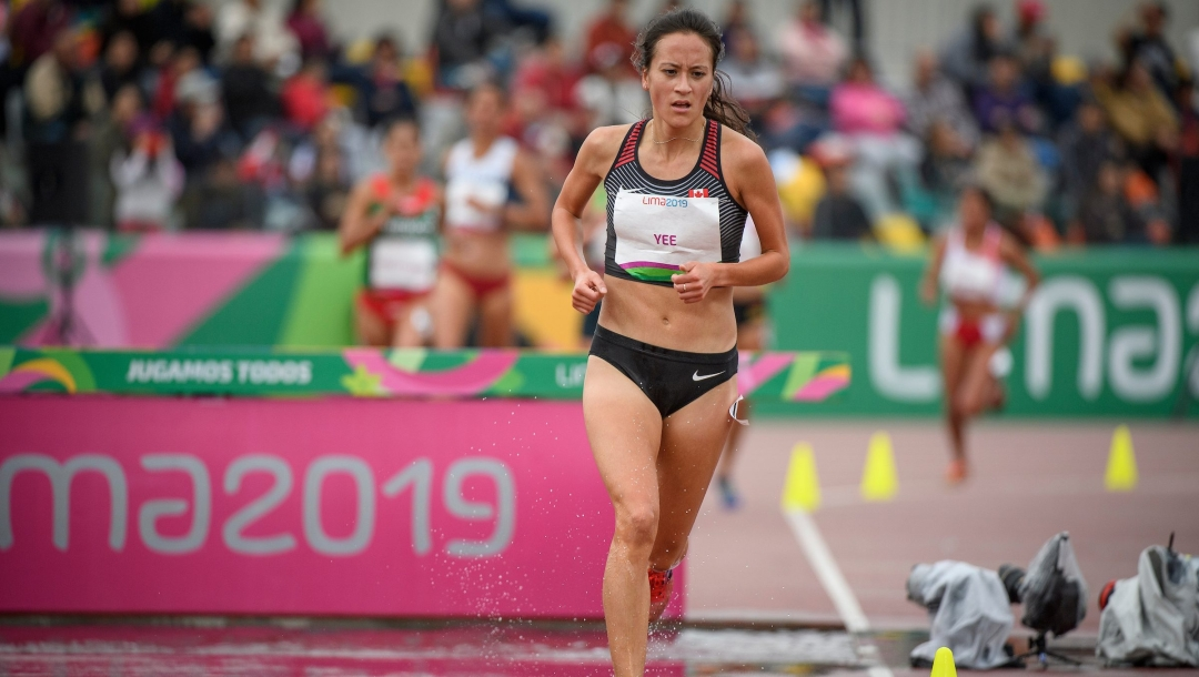 Regan Yee running on track