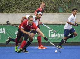 Taylor Curran of Canada battles for the ball