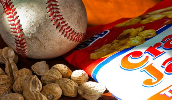 A bag of Cracker Jacks and peanuts and a baseball