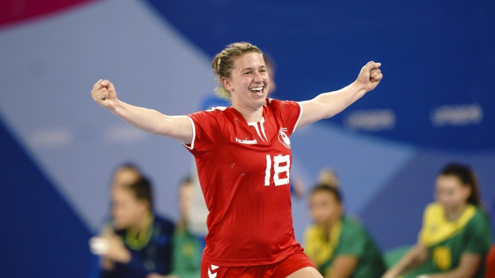 Catherine LŽger of Team Canada celebrates