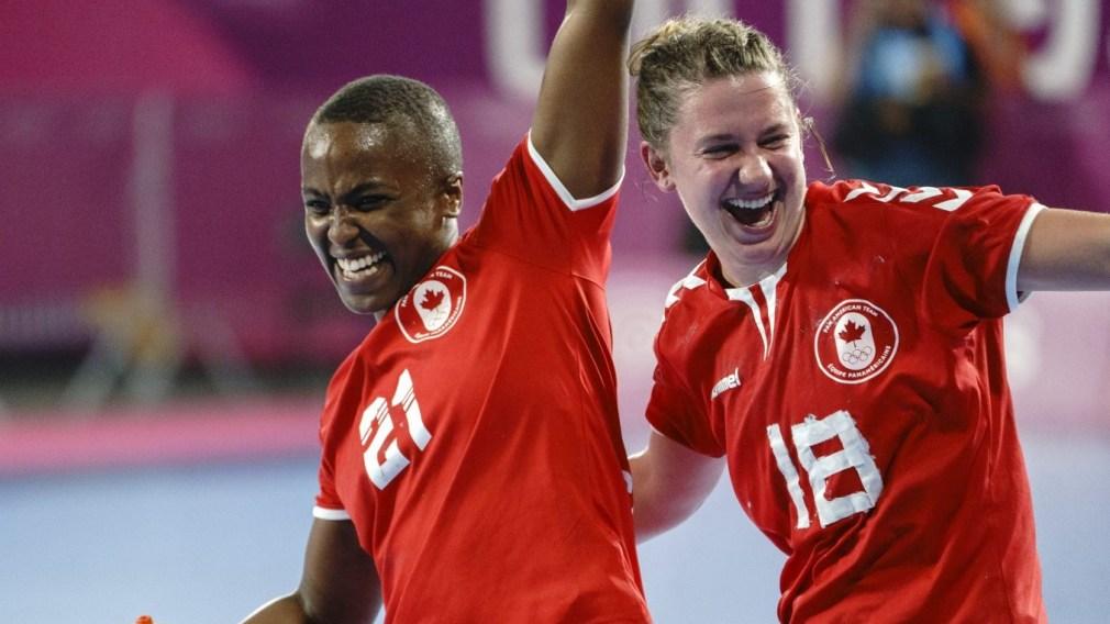 Two Canadian handball players smiling