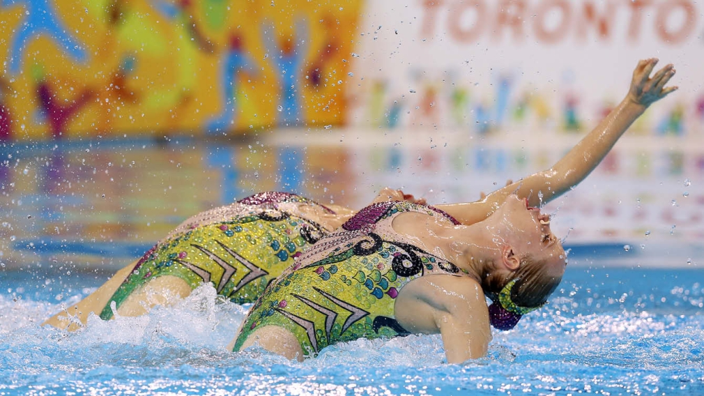 Two synchronized swimmers competing