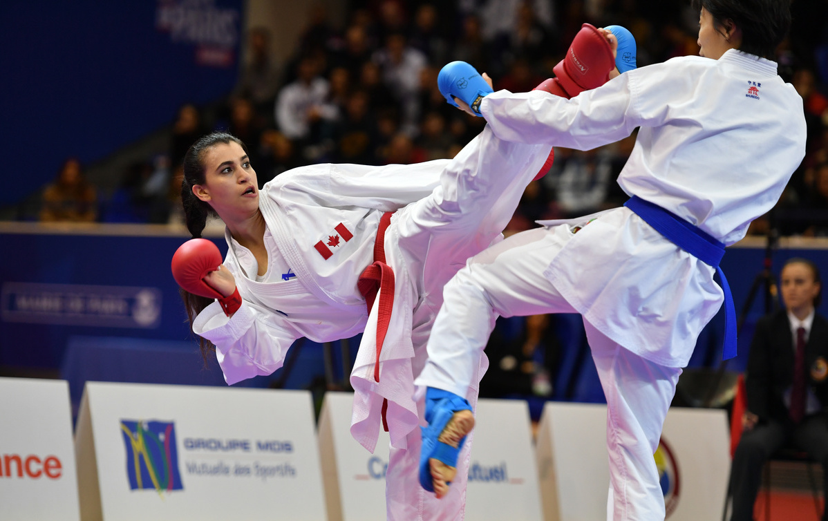 Canada's Haya Jumaa competes against an opponent from China