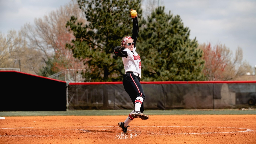 Morgan Rackel, on the mound, starts her pitching movement as she plays for the Austin Peays.