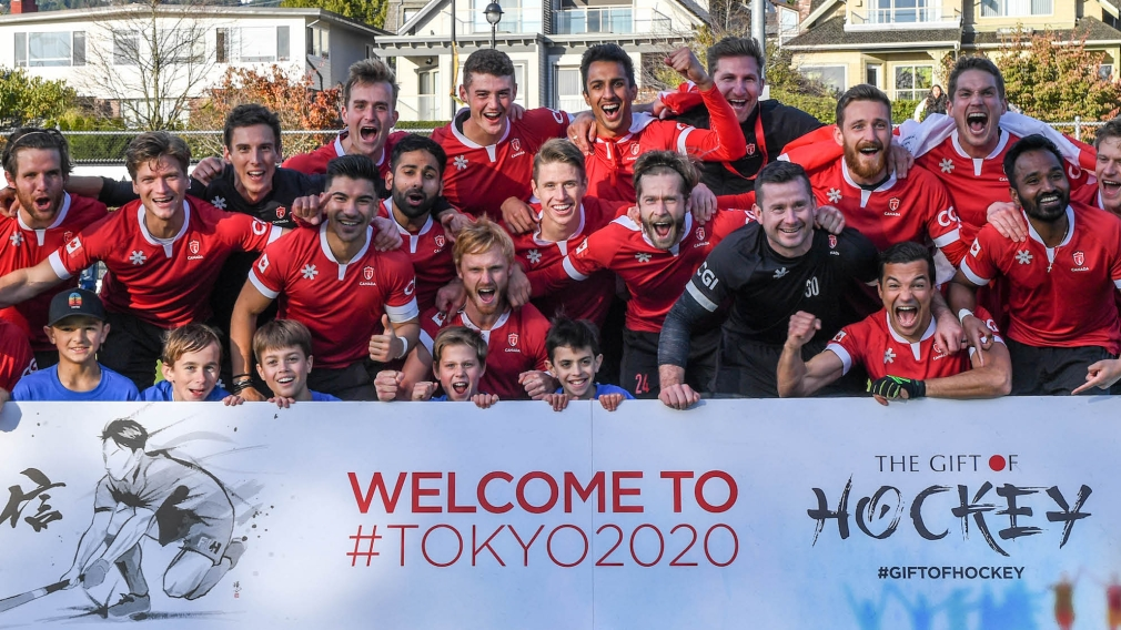 The Canadian men's field hockey team celebrates with a picture after defeating Ireland to qualify for the Tokyo 2020 Olympic Games.