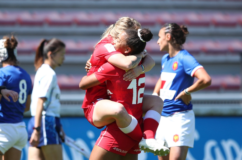 Rugby players hugging