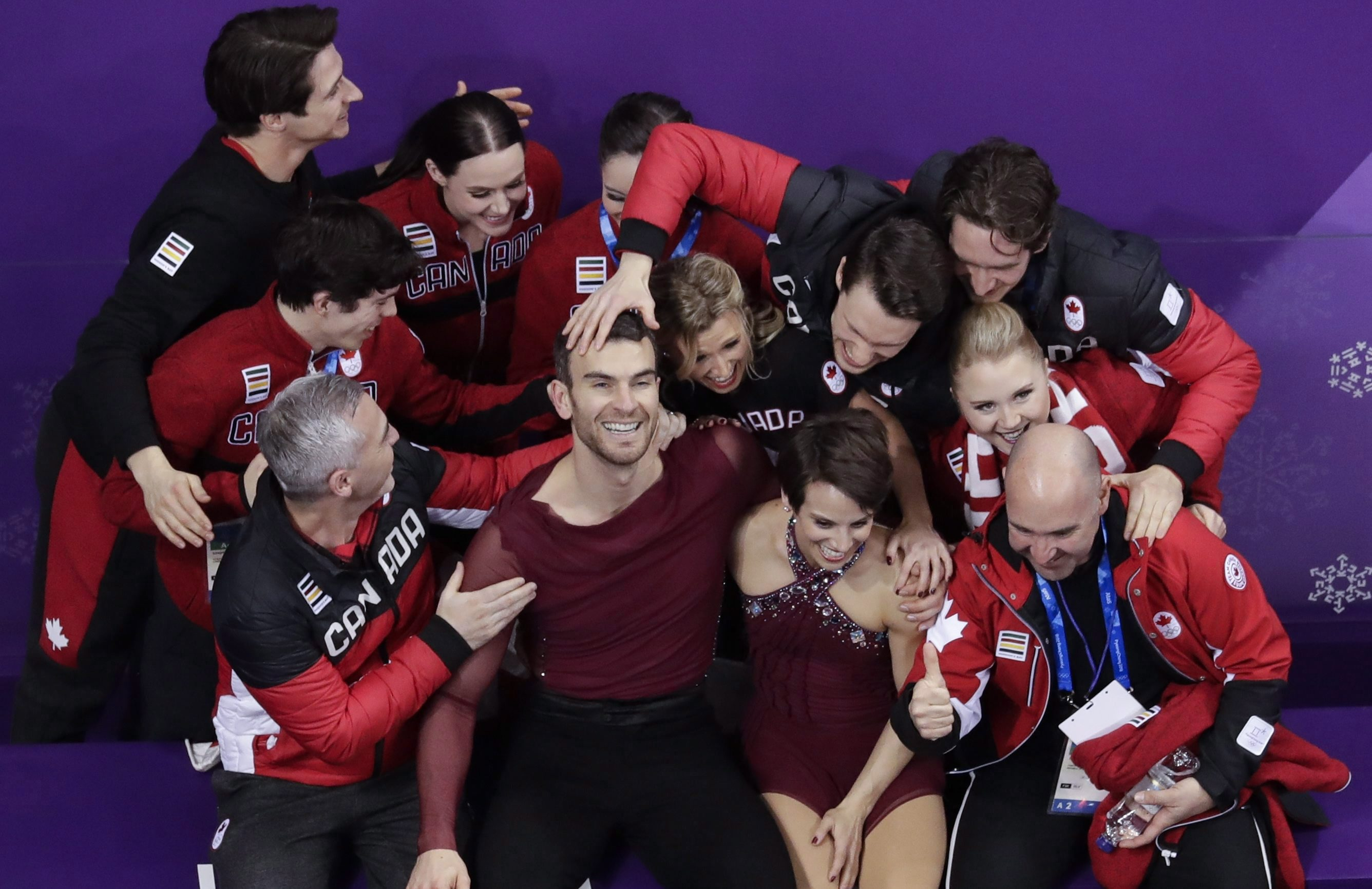 Canadian figure skating team reacts after performing