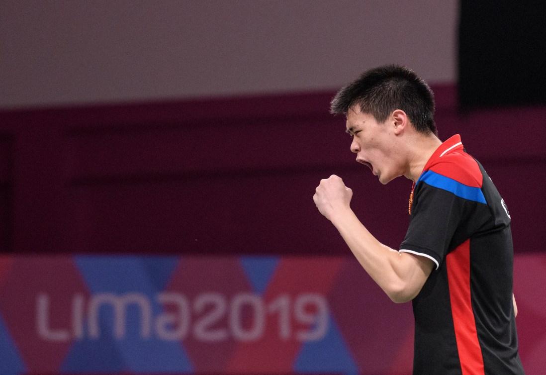 Brian Yang celebrates during a game at Lima 2019.