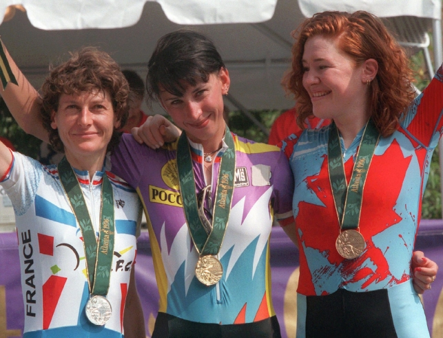 Olympic individual cycling time trials medalists pose with their medals
