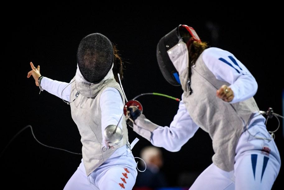 Jessica Guo (left) competes against Saskia van Erven Garcia of Columbia during the women's foil individual.