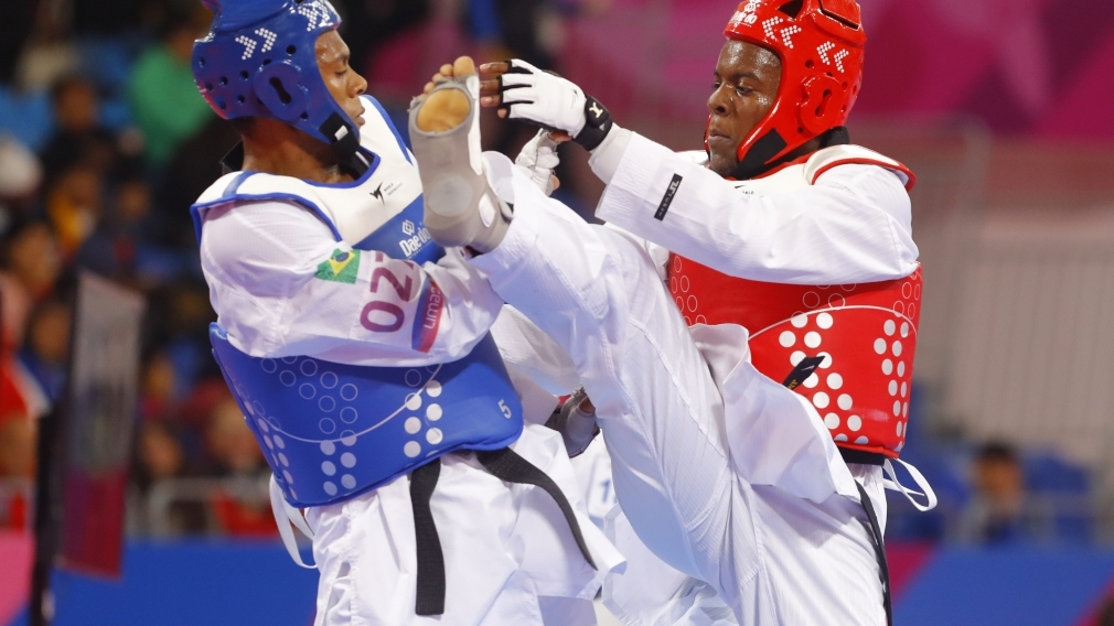 Jordan Stewart (right) competes against Maicon Andrade from Brazil.