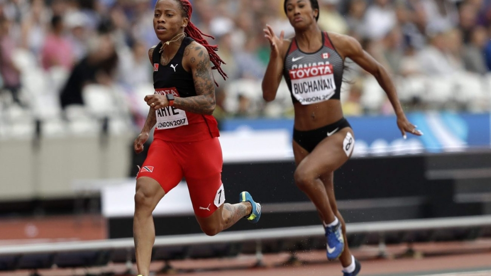 Leya Buchanan running beside Trinidad and Tobago's Michelle-Lee Ahye