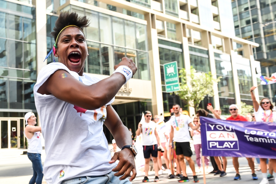 Krystina Alogbo celebrates during the Montreal Pride Parade in 2018.