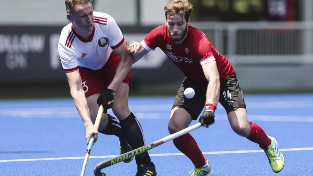 Kirkpatrick James of Canada, right, collides with Krysiuk Illia of Belarus while reaching balL