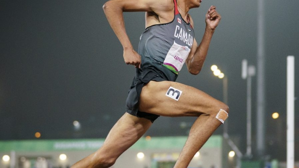 Pierce Lepage of Canada competes in the 400m race during the decathlon