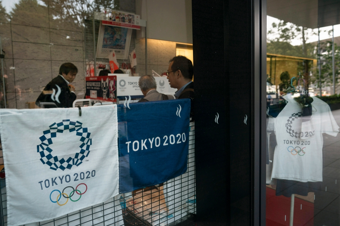 People shopping at a store selling Olympic souvenirs in Tokyo on June 19, 2019.