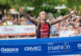 Tyler Mislawchuk crosses the finish line.