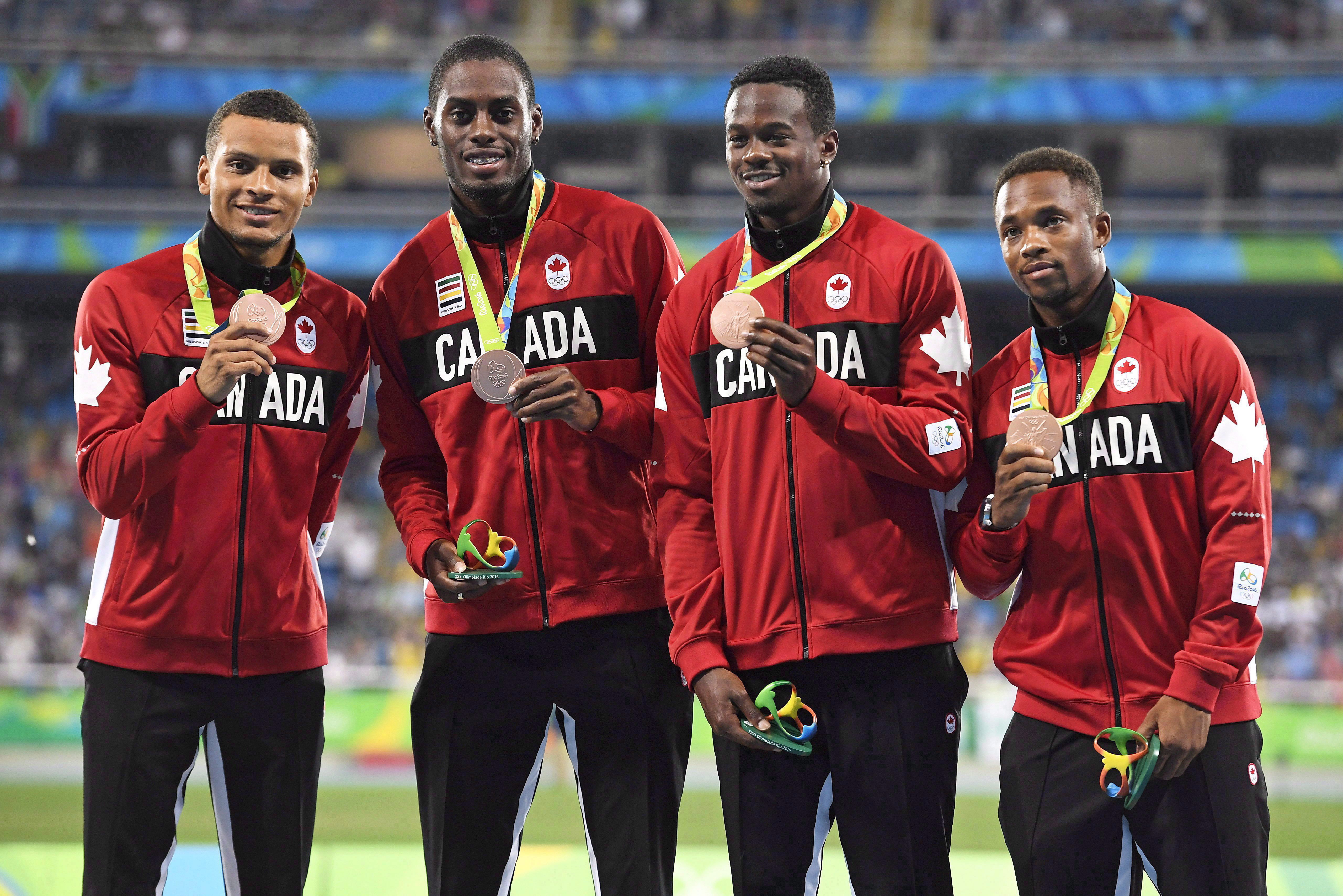 Akeem Haynes Aaron Brown, Brendon Rodney and Andre De Grasse pose with bronze medals on the podium