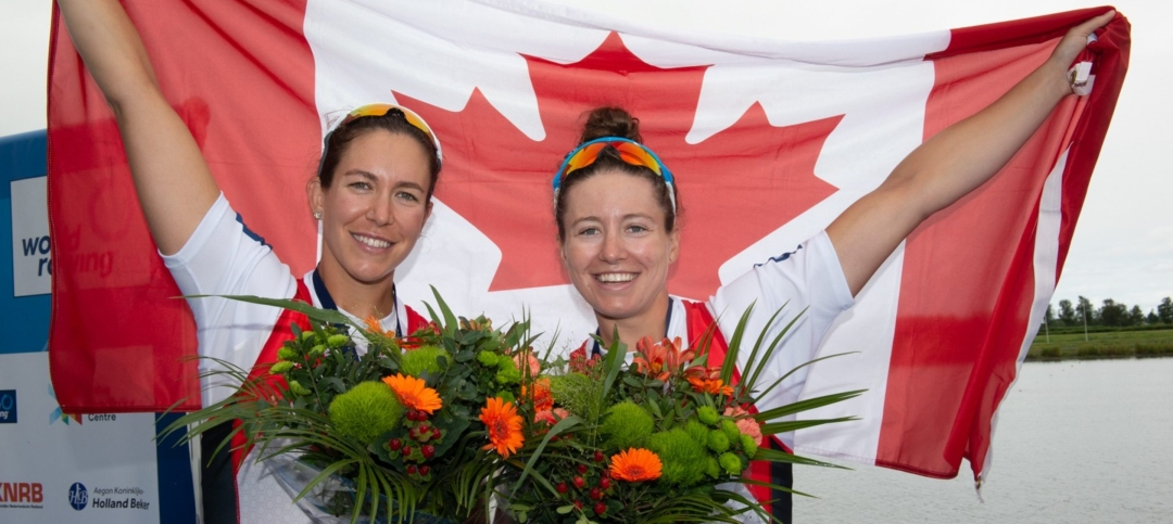 Canadian athletes pose with flag and flowers