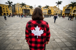 Woman with maple leaf flannel site seeing in Lima