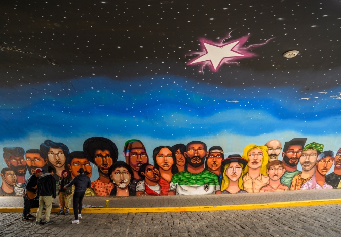 Street art showing locals starring at a star in the sky