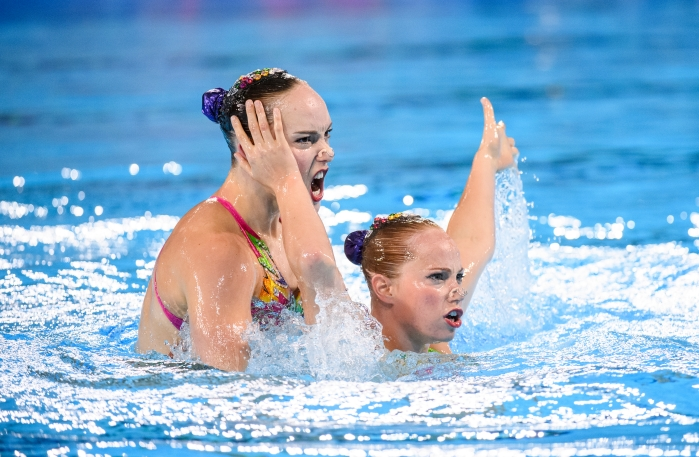 Claudia Holzner and Jacqueline Simoneau in the water