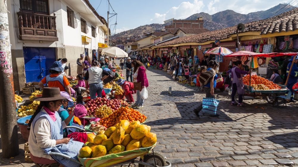 A busy street featuring many locals in the city of Cusco.