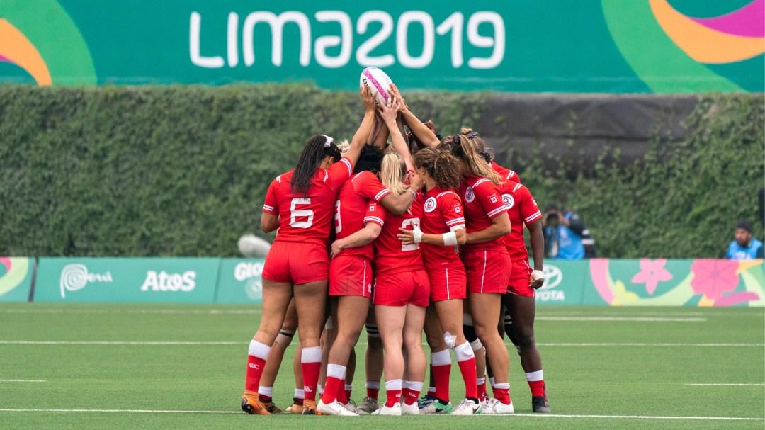 Rugby team huddling