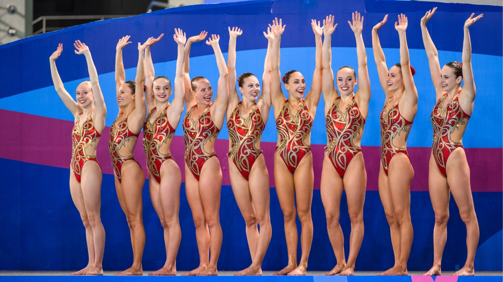 Line of gymnasts celebrating
