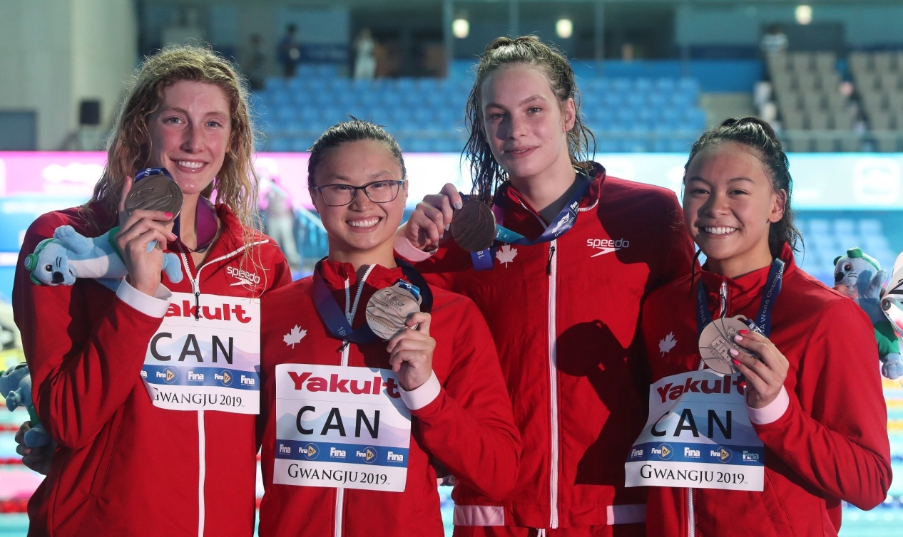 Team Canada qualified for Tokyo 2020 in the women's 4x100m freestyle relay event after winning bronze on day one of the FINA World Championships in Gwangju, South Korea.  Posting a time of 3:31.78, today's (July 21, 2019) bronze medal team included Kayla Sanchez, Taylor Ruck, Penny Oleksiak and Margaret MacNeil.