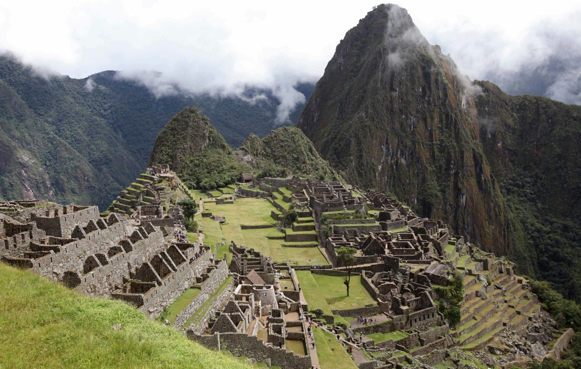 Machu Picchu site showing the mountains and old city ruins