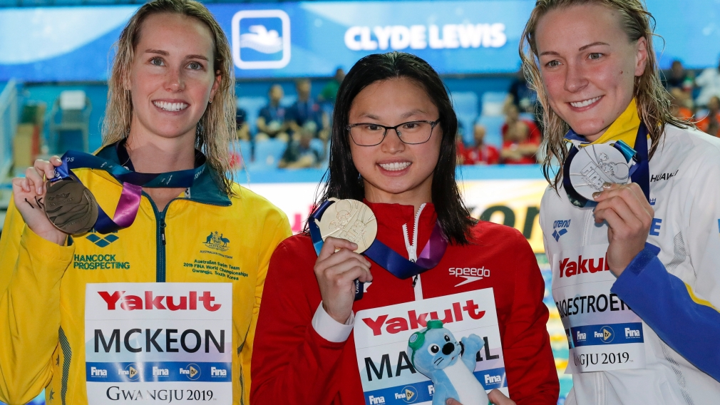Gold medalist Canada's Margaret MacNeil, centre, stands with silver medalist Sweden's Sarah Sjostrom, right, and bronze medalist Australia's Emma McKeon
