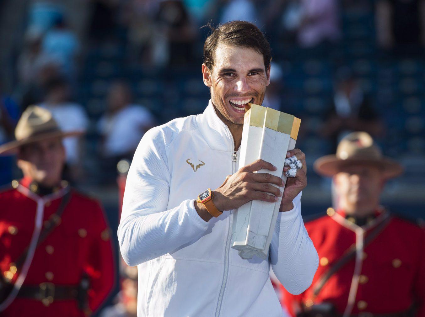 Rafa Nada celebrates with trophy