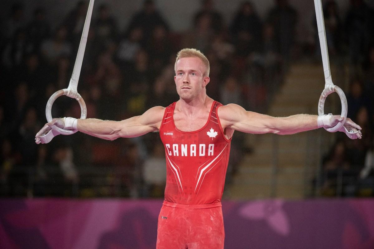 Canadian gymnast hangs on the rings