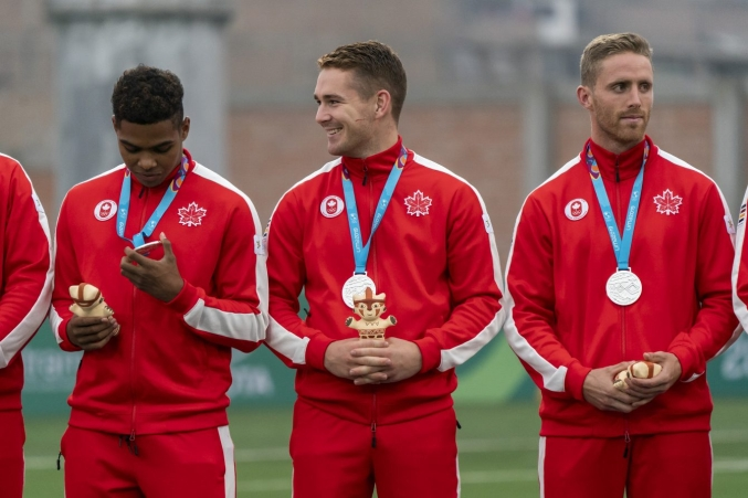 Image of Team Canada's rugby men on the Lima podium.