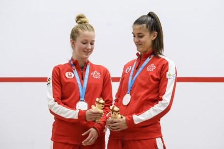 Team Canada squash women stand on the podium.