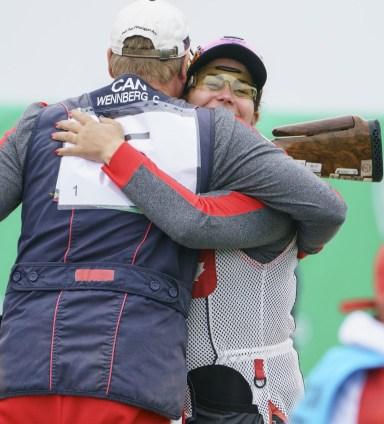 Amanda Chudoba and Curtis Wennberg hug