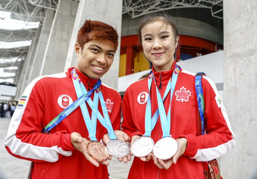 Assadian Jr. (left) and Jinsu Ha, pose for photos with their medals