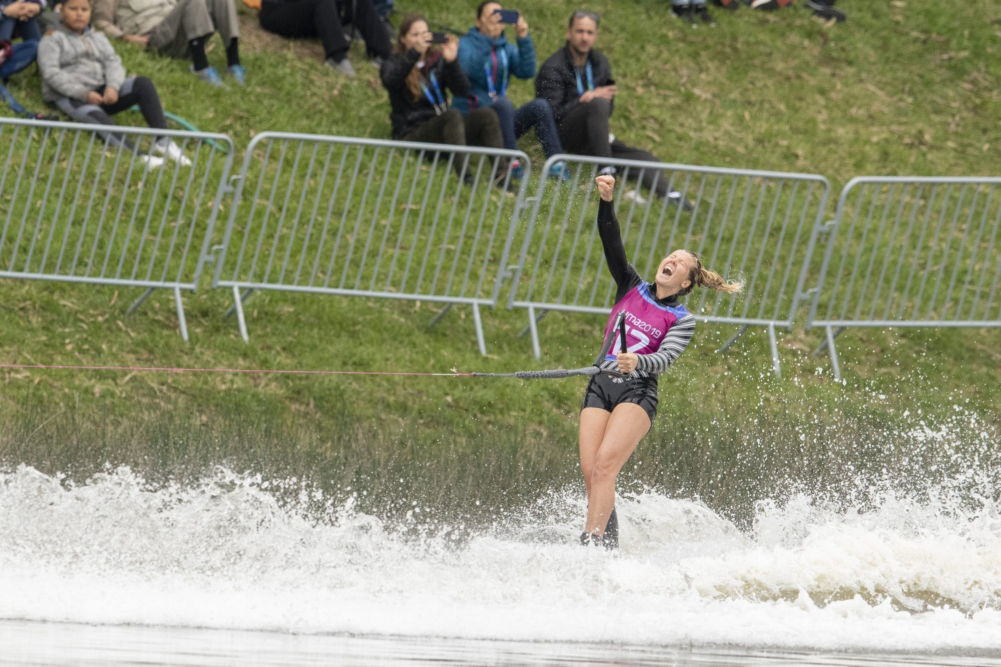 Waterskier pumps fist on water