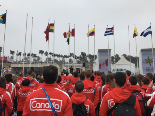 Athletes watching the flags raise