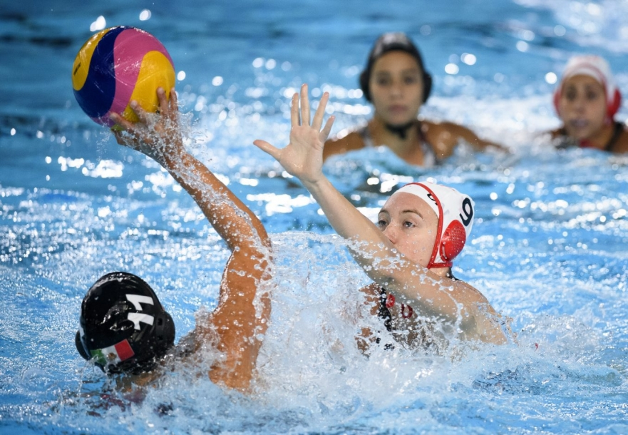Hayley McKelvery of Canada attempts to block a pass