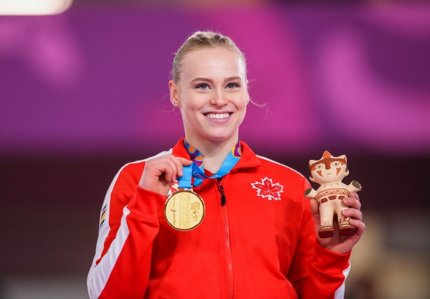 Ellie Poses with her gold at Lima