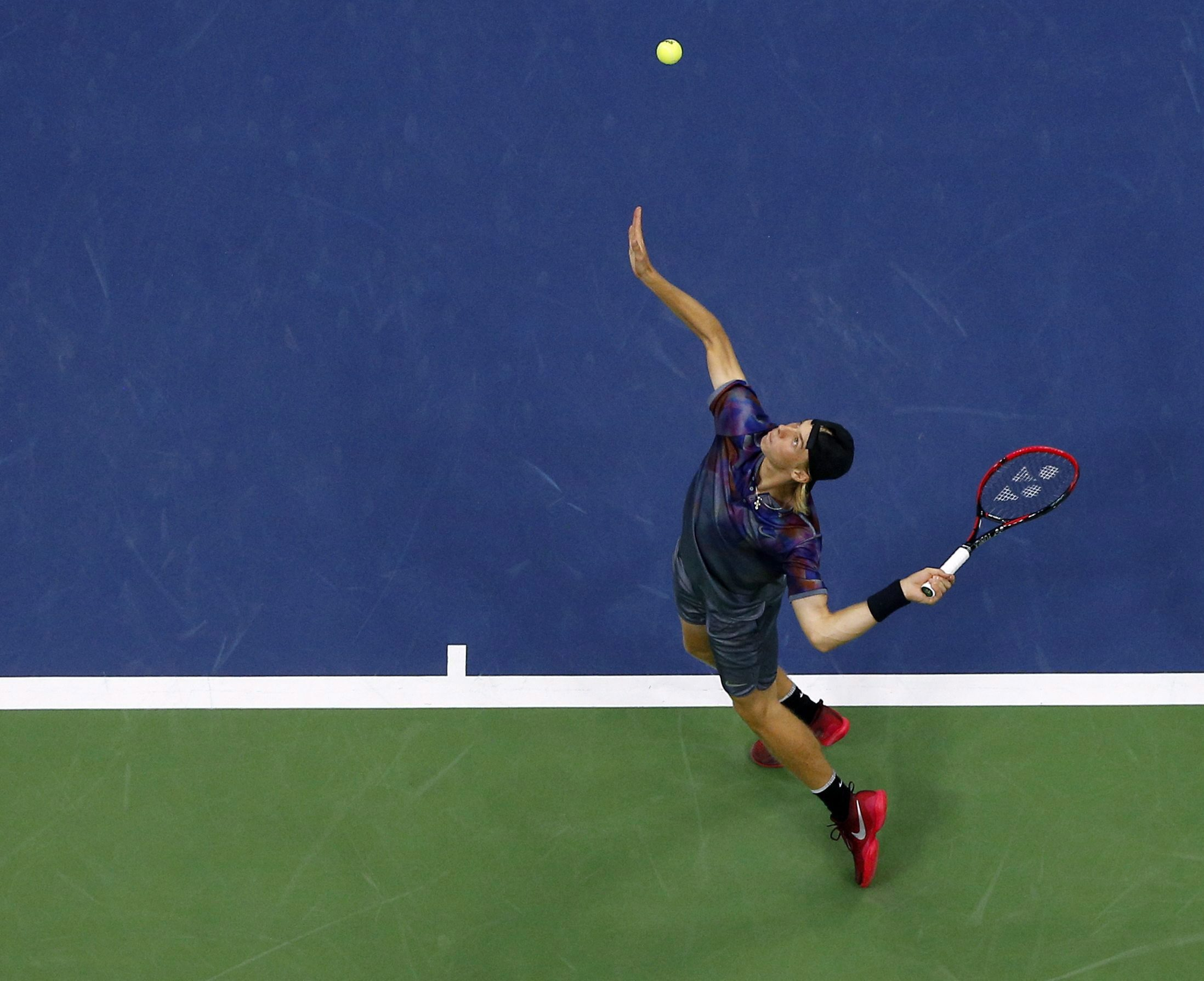 Denis aerial shot of a serve