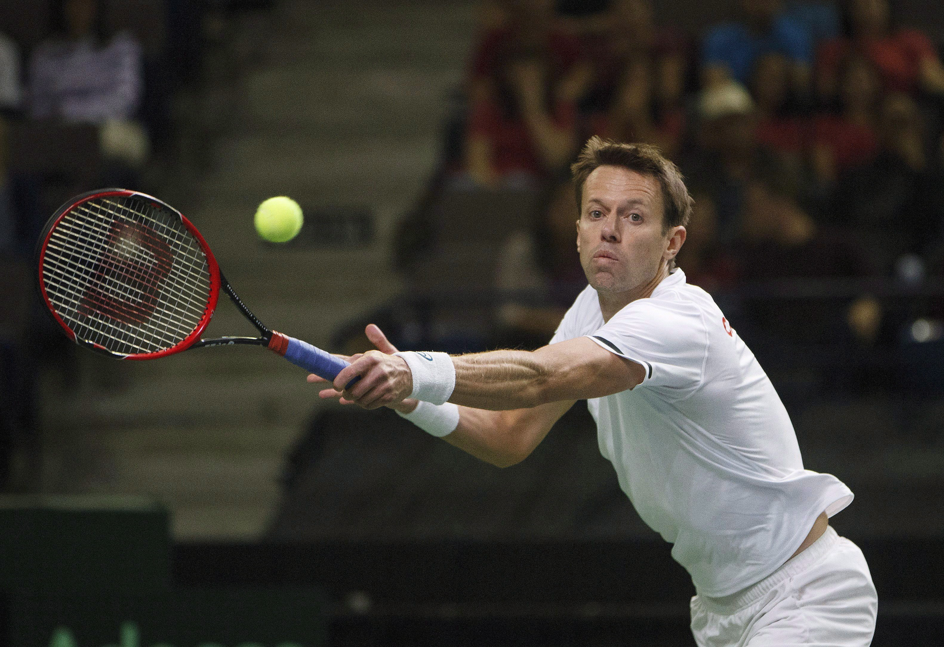 Daniel Nestor about to hit the ball