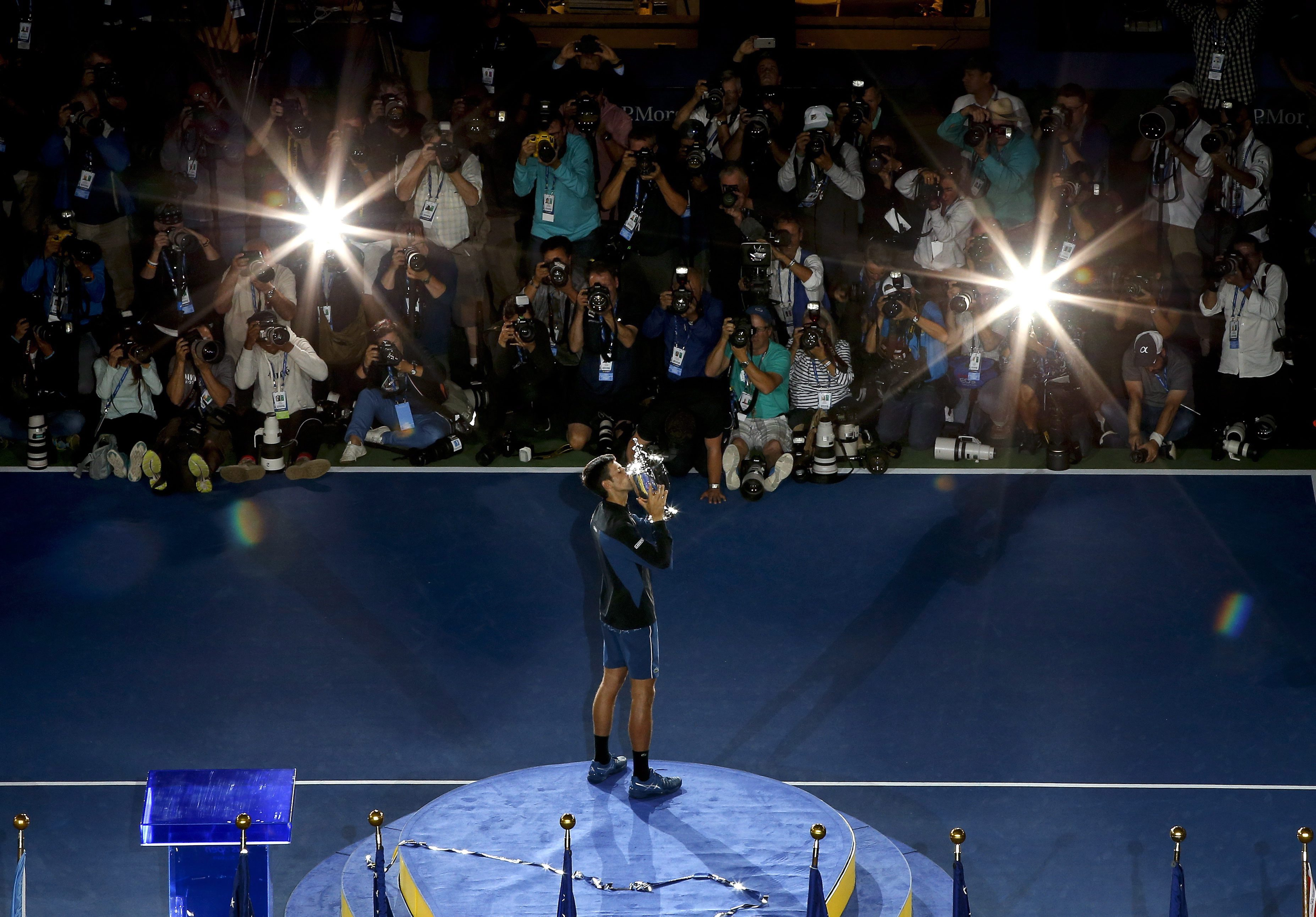 Novak Djokovic kisses the US Open trophy